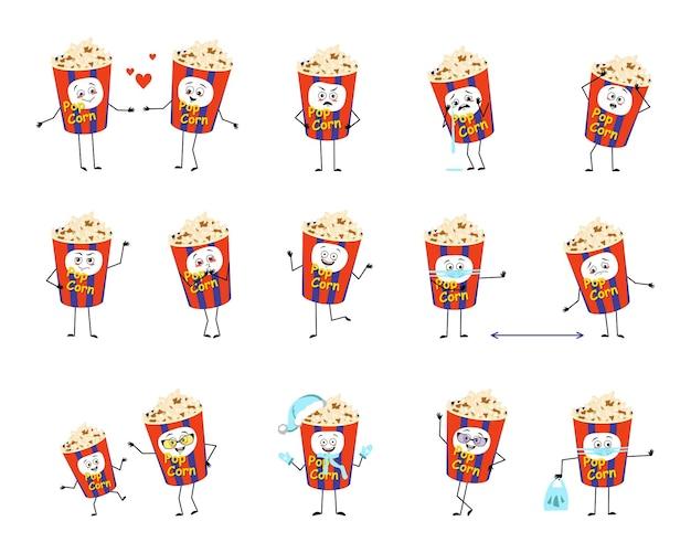Set di popcorn in una scatola delle vacanze personaggi con emozioni faccia mani e gambe spuntino felice o triste per ...