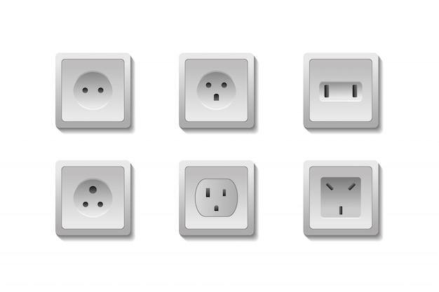 Set di prese elettriche europee e usa realistiche su sfondo bianco.