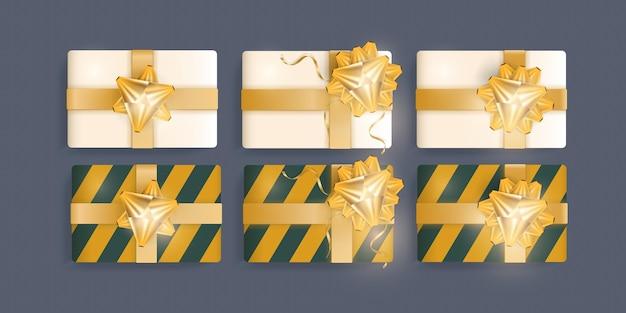 Set di regali realistici con nastro d'oro e fiocco. vista dall'alto. vettore.