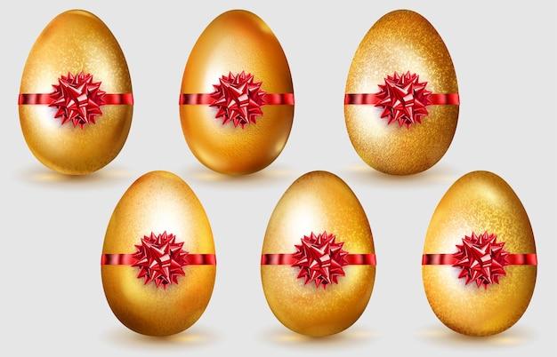 Set di realistiche uova di pasqua dorate con fiocchi rossi, riflessi e ombre morbide su sfondo bianco