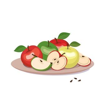 Set di mele rosse e verdi su un piatto