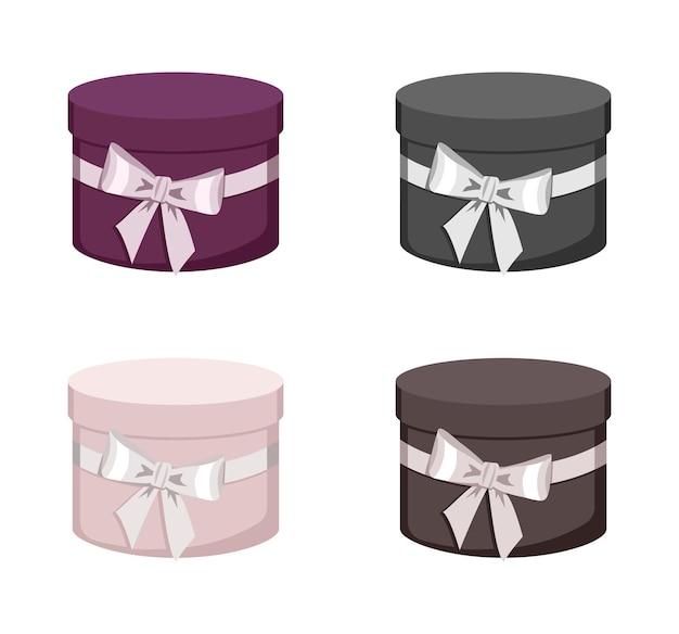 Una serie di contenitori di regalo rotondi isolati su bianco
