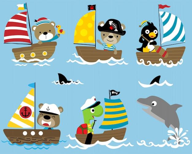 Set di cartone animato marinaio sulla barca a vela con un delfino