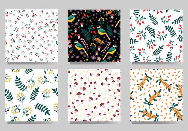 Insieme del modello senza cuciture stile scandinavo. olivello spinoso disegnato a mano, rosa canina, mirtilli rossi, piante selvatiche, funghi, paro uccello.