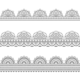 Set di bordi senza soluzione di continuità. decorazione in stile etnico orientale, indiano. ornamento di doodle. illustrazione di tiraggio della mano di contorno. Vettore Premium