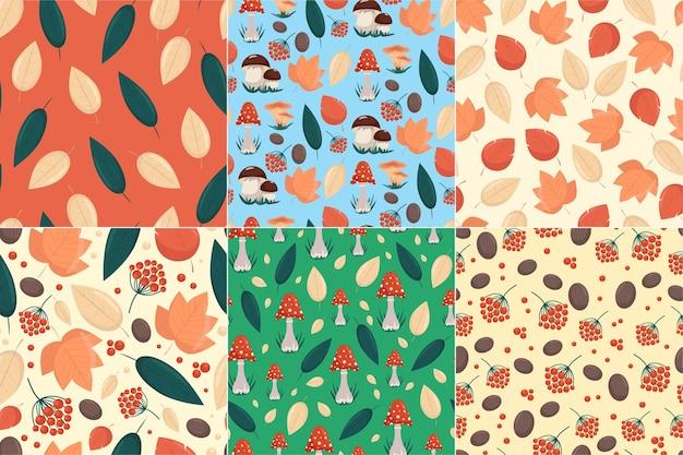Set di modelli senza cuciture con elementi autunnali foglie gialle funghi e bacche in stile piatto