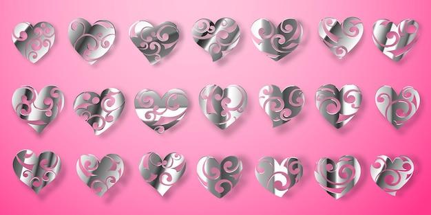 Set di simboli di cuore d'argento lucido con riccioli, riflessi e ombre su sfondo rosa