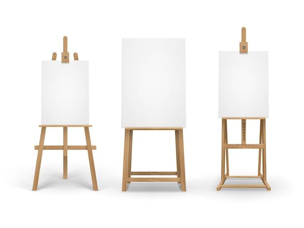 Set di cavalletti in legno color siena con tele vuote