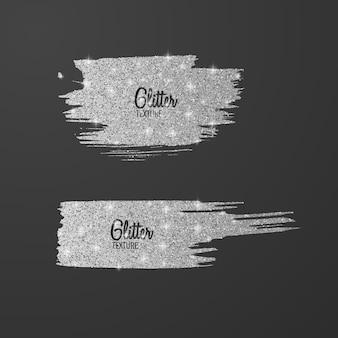 Set di pennelli glitter argento isolato su grigio