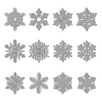 Set di fiocchi di neve glitter argento isolato su bianco