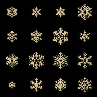Un insieme di sedici fiocchi di neve dorati di sollievo di lustro isolati su fondo nero. oggetto di decorazione scintillante cartolina di natale e capodanno.