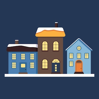Un insieme di piccole case carine con un tetto luminoso nella neve, luce nelle finestre e nei camini. buone decorazioni natalizie per capodanno e natale. elemento invernale e festivo