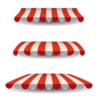 Una serie di tende da sole bianche rosse a strisce, tettoie per il negozio. tendalino per bar e ristoranti di strada