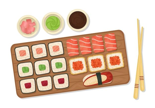 Set di sushi e panini su una tavola di legno con salsa di soia, wasabi e zenzero. cibo giapponese.