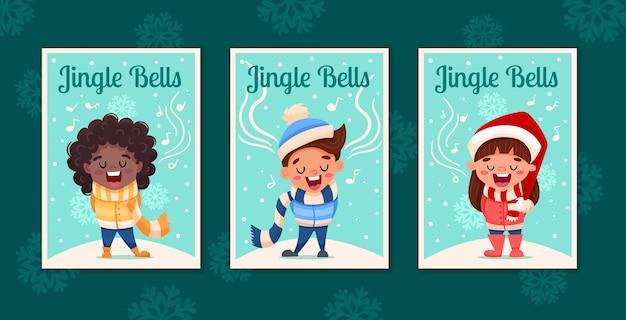 Set di tre cartoline d'auguri di buon natale con bambini svegli del fumetto che cantano canti natalizi jingle bells in stile vintage.