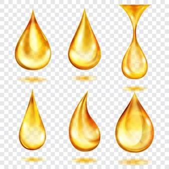 Set di gocce traslucide nei colori gialli, isolate su sfondo trasparente
