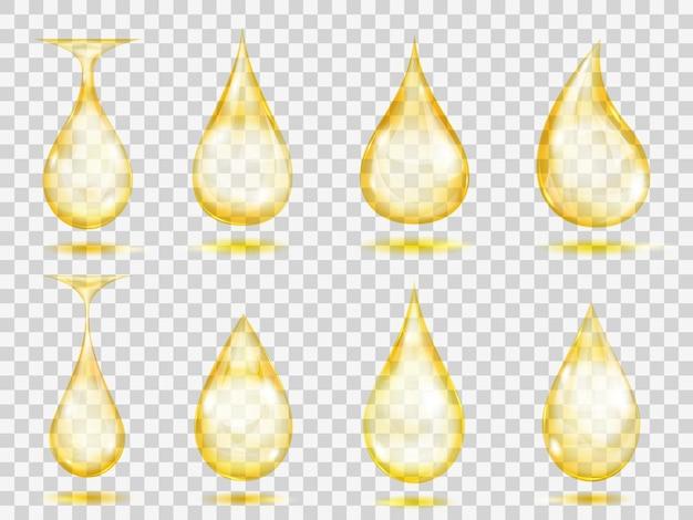 Set di gocce trasparenti nei colori gialli. trasparenza solo in formato vettoriale