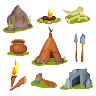 Insieme di vari oggetti preistorici. pietra con disegno, grotta, ossa e dente, arma e strumento di lavoro. tema dell'età della pietra