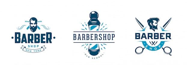 Insieme dei distintivi e degli emblemi d'annata del negozio di barbiere isolati su bianco