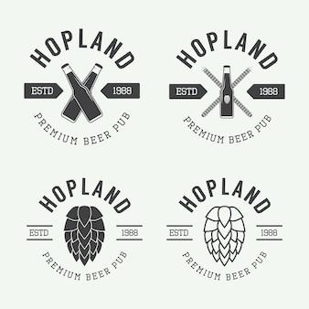 Set di loghi vintage di birra e pub, etichette ed emblemi con bottiglie, luppolo e grano