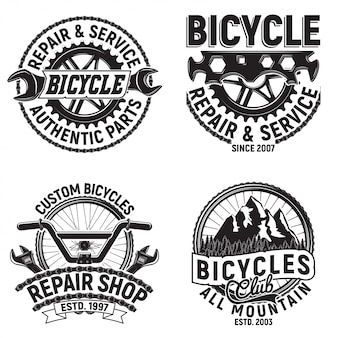 Set di disegni di logo del club di biciclette vintage, francobolli di stampa grange di motociclisti in discesa, emblemi di tipografia creativa di officina di riparazione di biciclette,