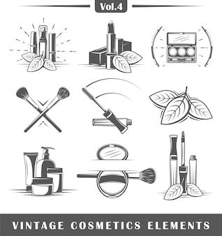 Set di elementi cosmetici vintage isolati su sfondo bianco.