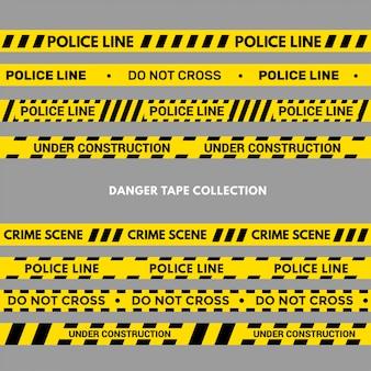 Set di nastri di avvertenza o di pericolo. striscia di polizia nera e gialla