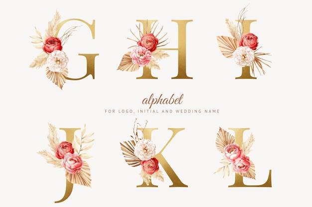 Impostare alfabeto floreale boho acquerello con lettera dorata