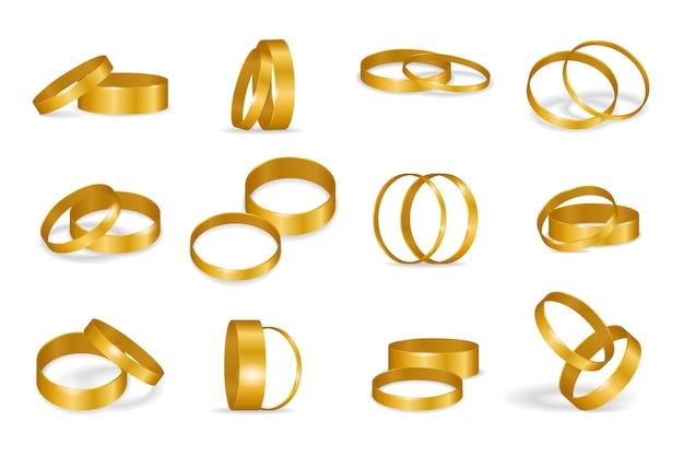 Set di anelli di nozze d'oro isolato