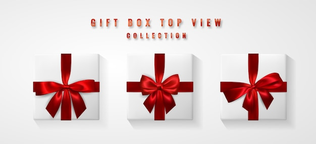 Set di scatola regalo bianca con fiocco rosso e vista dall'alto del nastro