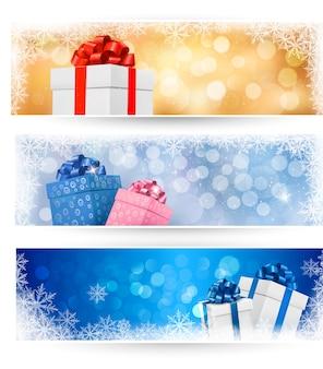Set di banner di natale invernale con scatole regalo e fiocchi di neve