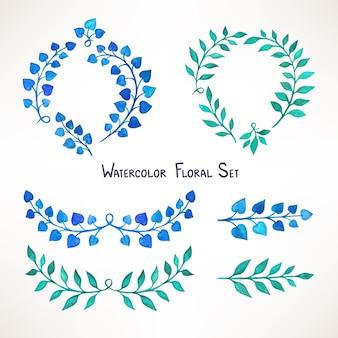 Set con un ramo con foglie verdi e blu dell'acquerello