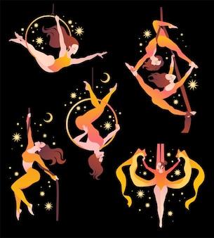 Set con ginnaste su sete aeree, su un anello, su una corda.
