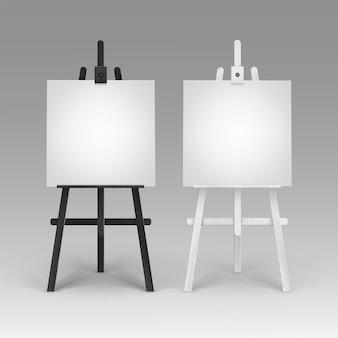 Set di cavalletti bianchi neri in legno con mock up tele quadrate vuote vuote isolate su priorità bassa
