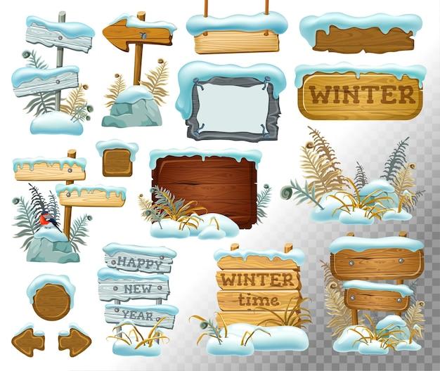 Set di tavole di legno con cumulo di neve.