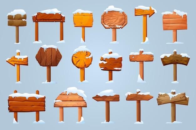 Set di insegne di pilastri di legno in pannelli informativi vettoriali isolati dalla neve frecce di guide vuote