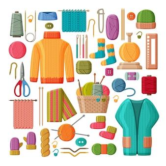 Set di vestiti lavorati a maglia di lana e strumenti di lavoro a maglia isolati su priorità bassa bianca.