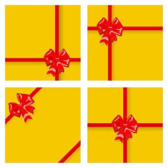 Set di scatole regalo gialle, legate con nastri e fiocchi rossi, con ombre. vista dall'alto. design piatto