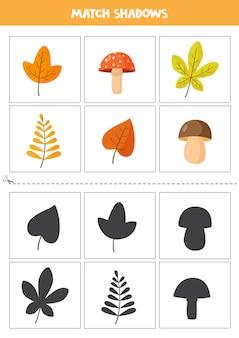 Schede di corrispondenza delle ombre per bambini in età prescolare. fogli e funghi di autunno.