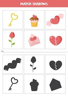 Schede di abbinamento ombra per bambini in età prescolare. elementi di san valentino del fumetto.