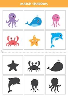 Schede di corrispondenza delle ombre per bambini in età prescolare. set di simpatici animali marini.