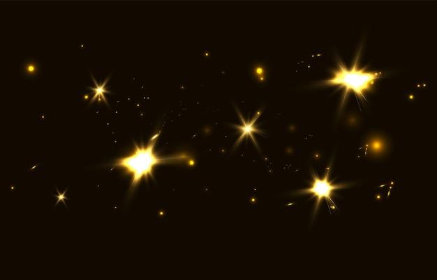 Bokeh brillante isolato su sfondo nero luci dorate bagliore bagliore natalizio
