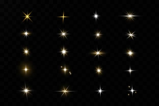 Stelle dorate brillanti su fondo nero. effetti, bagliore, linee, glitter, esplosione, luce dorata. illustration.set.