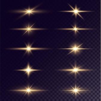 Brillanti stelle dorate isolate su sfondo nero stella leggera con abbagliamento