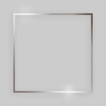 Cornice lucida con effetti luminosi. cornice quadrata argento con ombra su sfondo grigio. illustrazione vettoriale