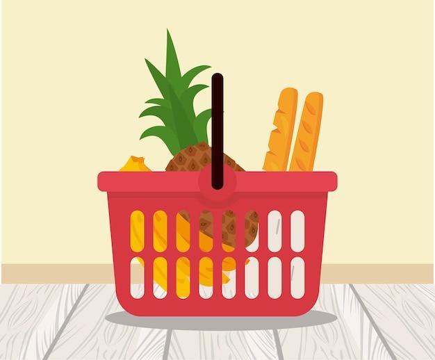 Cestino della spesa con banane ananas e pane