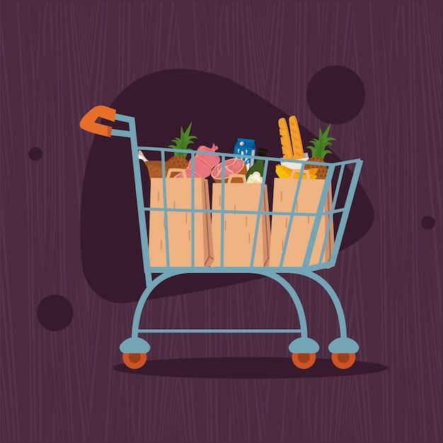 Carrello della spesa con sacchetti di cibo