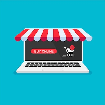 Carrello della spesa con pulsante rosso notifica di ordinazione online sullo schermo del laptop acquisti a casa