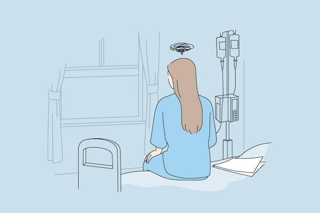 Donna ammalata che si siede nel letto di ospedale