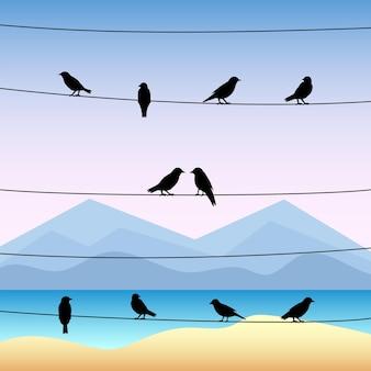Sagoma di uccelli sui fili con paesaggio marino tropicale.